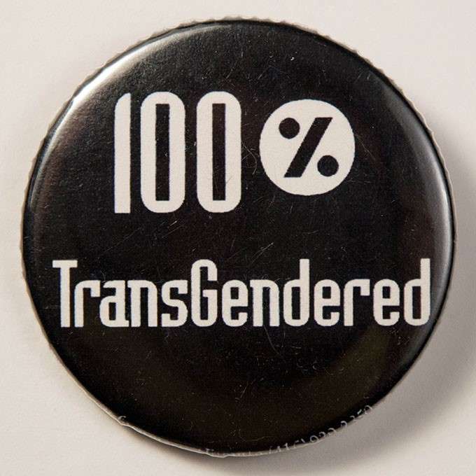 Cover image of 100% transgendered. Button.