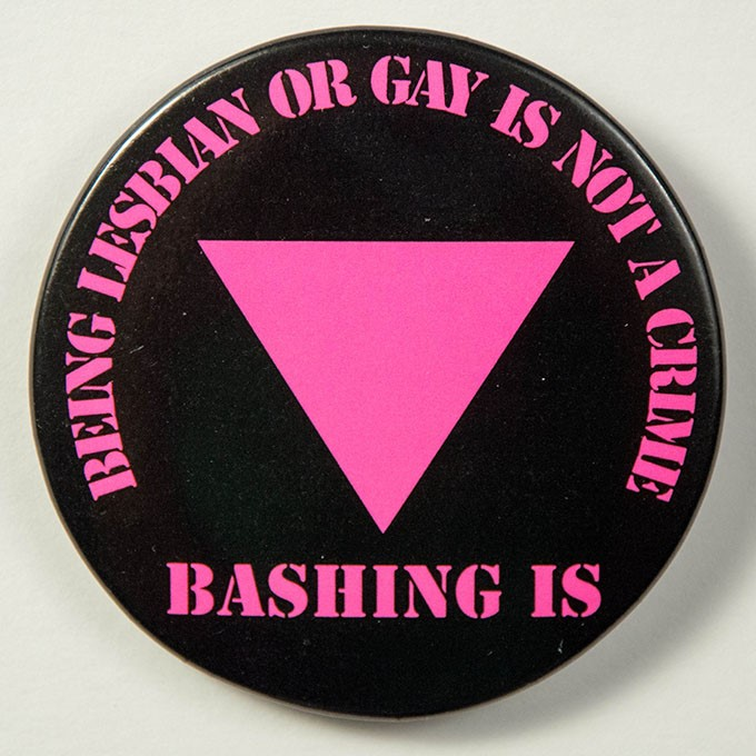 Cover image of Being lesbian or gay is not a crime: bashing is. Button.