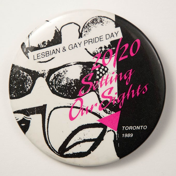 Cover image of 20/20 setting our sights. Lesbian & Gay Pride Day Toronto 1989. Button.